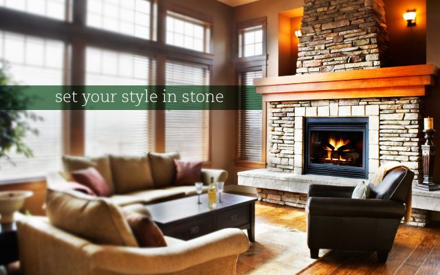 Set your style in stone. Living room with large stone fireplace